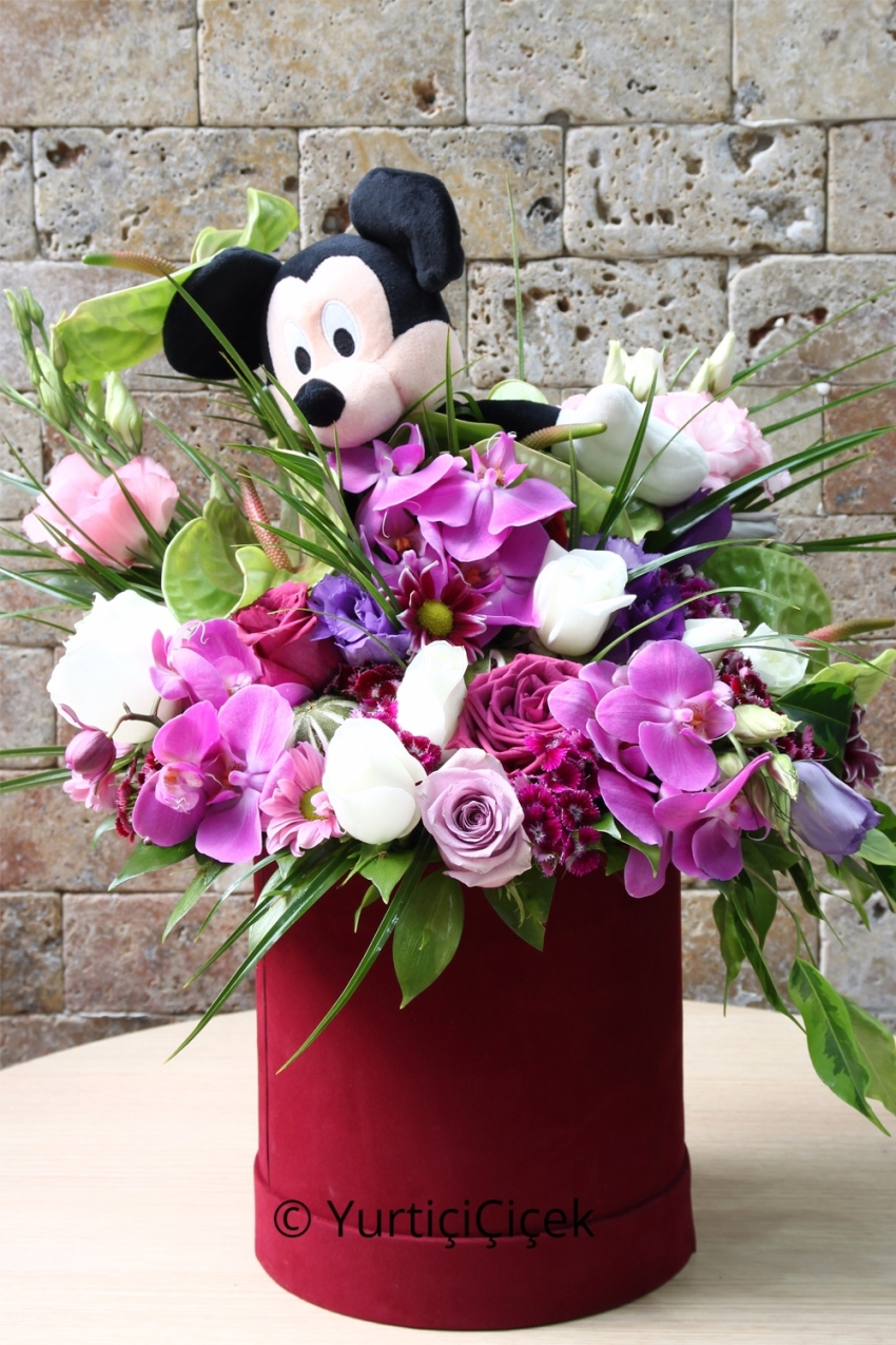 Arrangement prepared with the minnie toy with the innocent designs of orches, roses and wildflowers in box.