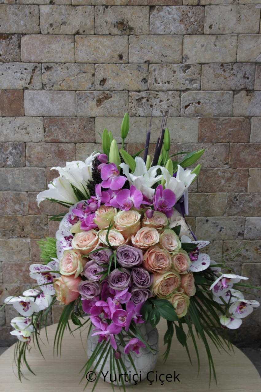 The magnificent harmony of purple and white spring flowers in a special wooden box will make you happy.