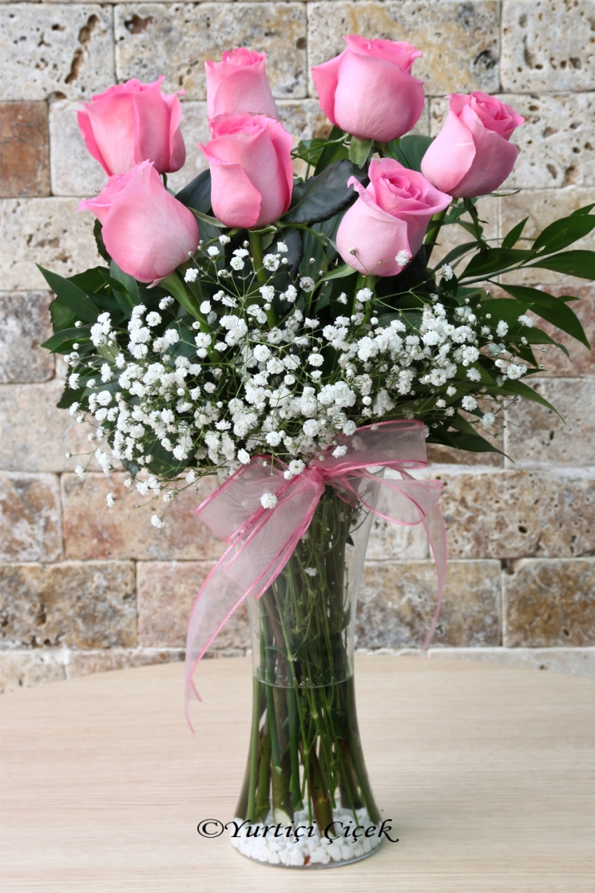 You can present an innocent turn of love to your loved ones with the boutique flower design prepared with 7 Pink Rose of Equator. Approximate Product Size: 55 cm