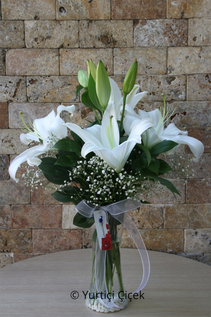 White Lilies: 2 Pieces    Fragrant white lilies in a glass vase, water, is designed to be the most stylish. Will be one of the most beautiful gifts from loved ones to send.
