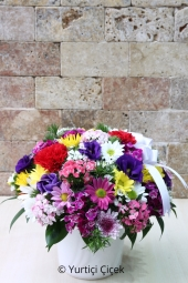 Colorful Arrangement   Yellow, pink, purple, white ceramic of all colors in the arrangement of the season with your loved ones feel special.