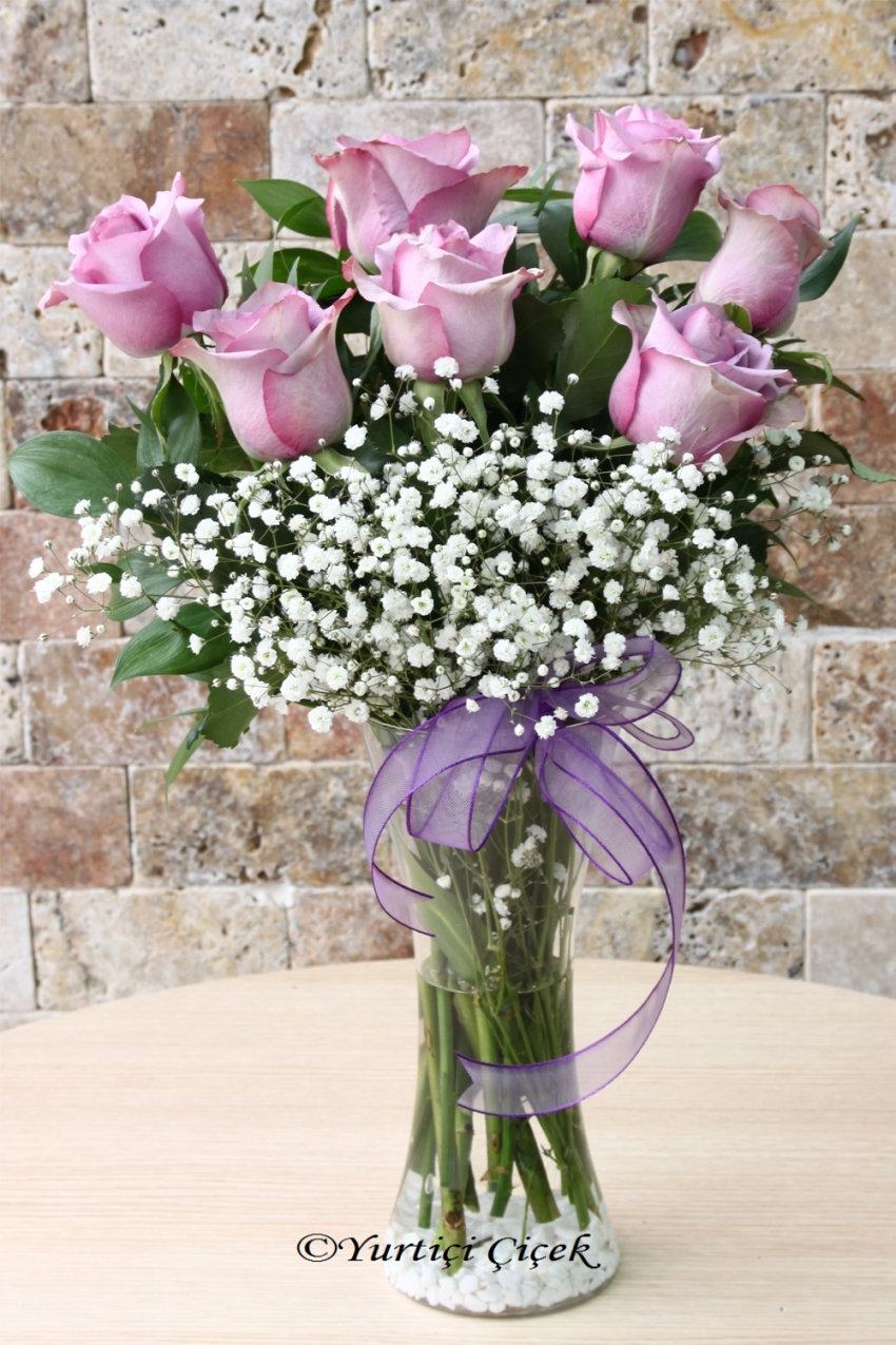 Send an innocent floral design to your loved ones with the boutique flower design prepared with 7 pieces of Lila Ecuadorian Rose. Approximate Product Size: 55 cm