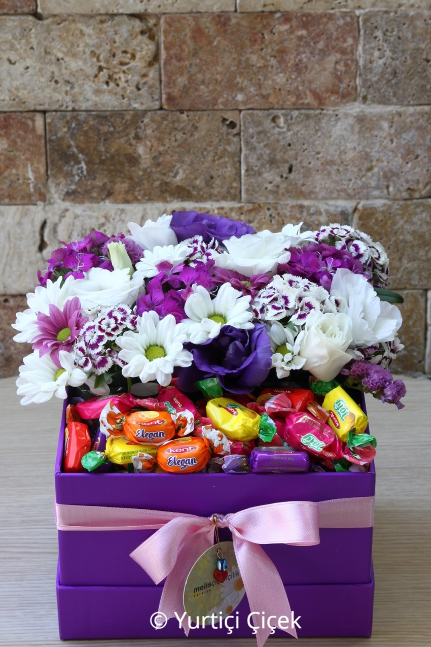 Purple box design, will be able to please your loved ones prepared with colorful seasonal flowers.