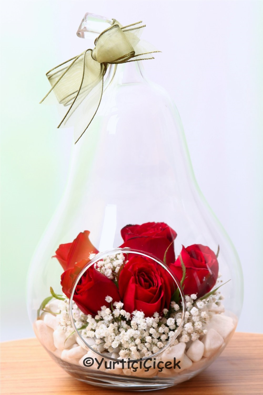 Special Design Pear-shaped arrangement of red roses in a vase waiting for you to please your loved ones.