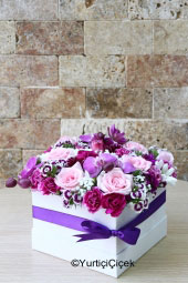In the White Box, you can send the best floral design of the season with purple orcasters, colorful countryside flowers.